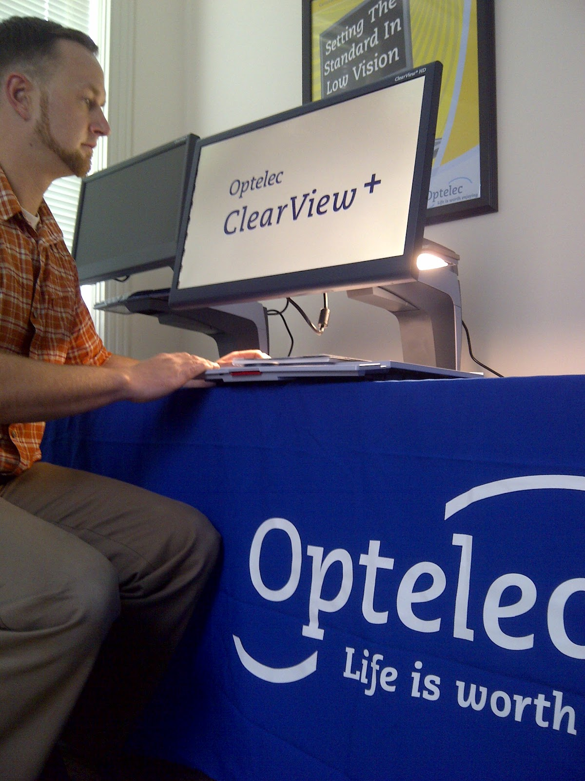 Man using the Optelec product.