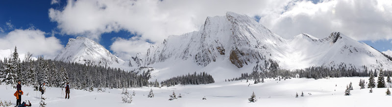 Photo: Cross-Country Skiing Panorama in Canmore  Andy took Katie, Joe, and I cross-country skiing when we visited him in Canada around the time of his graduation. It was a beautiful day in the Canadian Rockies, and though I fell a lot, I really enjoyed skiing. This is where we ate lunch.