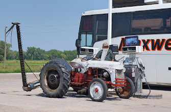 Photo: Maxwell, NE: Sounds like the start of a joke: A bus and an old tractor pull into a gas station in Nebraska...