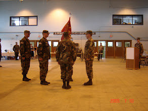 Photo: A Battery Change of Command, 10 July 2005. Outgoing commander Phill Trevino, Incoming CPT Grant Delaware, Bn Cdr Chuck McFarland.  1SG Mike Lord, MC LT Zeb Murray.