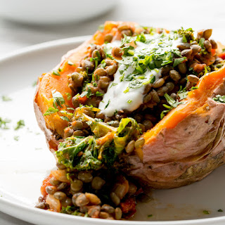 Stuffed Sweet Potatoes with Lentils, Kale and Sun Dried Tomatoes.