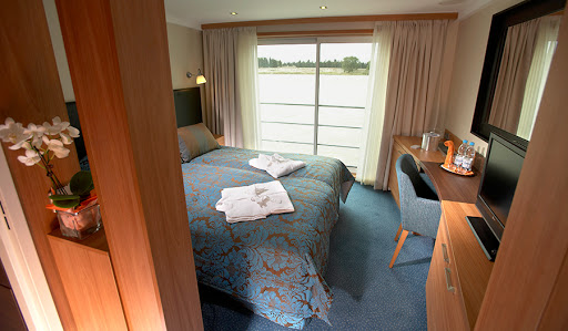 Avalon-Scenery-Deluxe-Stateroom - Wake up to a beautiful view of France gliding by your deluxe stateroom on Avalon Scenery.