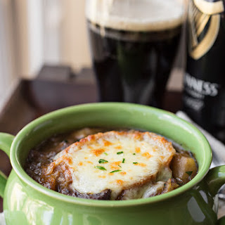 St. Patrick's Favorite Guinness Beef Stew with Potatoes, Rich Caramelized Onions & Cabbage, topped with Melty Garlic-Cheese Toast