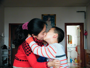 Photo: naughty son, warrenzh 朱楚甲 in 2012 lunar Spring Festival. family gathered for the lunar holiday even his dad, benzrad 朱子卓 received a much meaner bonus from his office, among the happy season. here son, warrenzh 朱楚甲 trying kissing his mom, emakingir.
