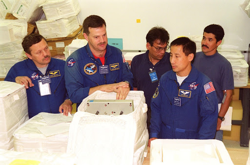 Members of the STS-106 crew check out part of the payload called TVIS on their mission to the International Space Station.