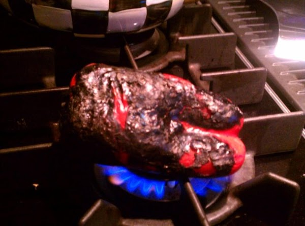Put whole pepper onto flame (please refer back to my comments above to get...