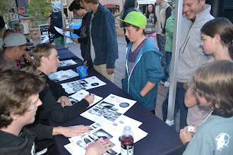 Photo: Blaze Kotsenburg signs an IRPC movie poster for a young fan
