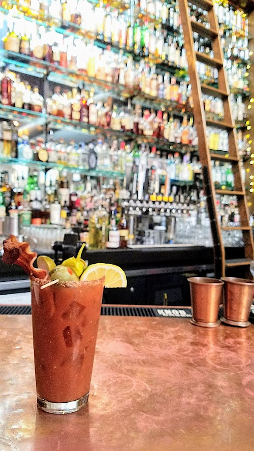 Circa 33 brunch, Bloody Mary c.1921 with vodka, summer-spiced bloody blend, creole-salt rim and choice of bacon/veggie/combo garnish