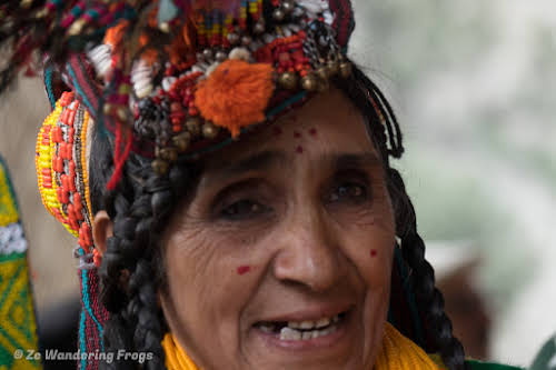 Pakistan Culture of the Kalash Valley Pakistan // A Kalasha woman in full traditional headgear