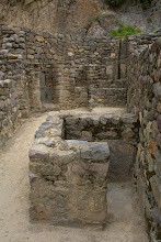 Photo: These bathroom facilities are located inside the house which is quite unusual for a time 700 years ago. Water basins in the back with water conduit in the natural rock above and subterranean outflows. The small room in front might have been a toilet.