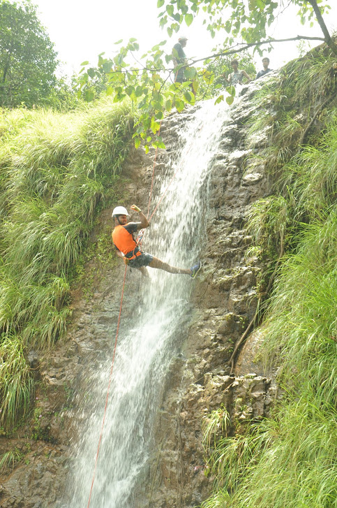 Waterfall rappelling in Monsoon at camp nisargshala