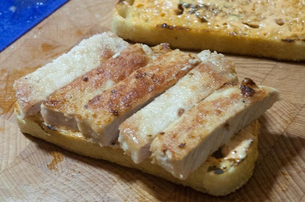 Place the cooked chicken, or pork on one slice of the bread.