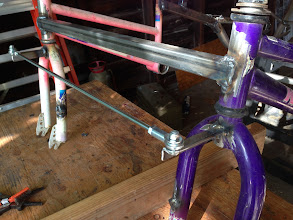 Photo: pitman arms and tie rod installed in front of bicycle forks