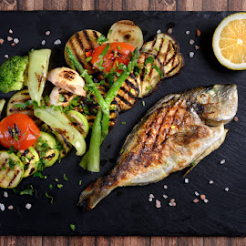 Fish dish  by Sorin Petculescu - Food & Drink Plated Food ( studio, color, natural, chef, bio, plate, vegetable, food, drink, stone, lemon, fish, eat, kitchen, grill, organic )