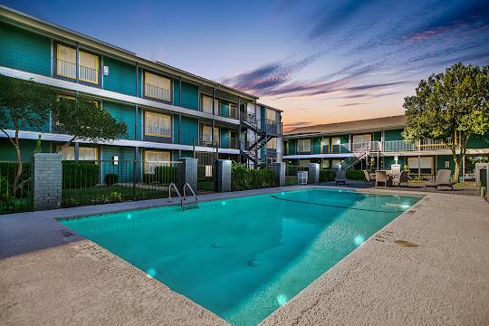 ATX North Apartments sparkling community pool at dusk