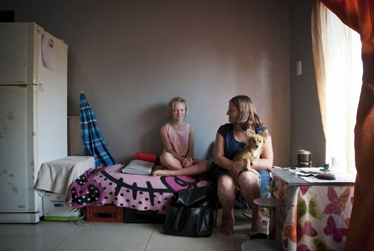 Susan Cloete and her daughter, Charissa, in their modest home in Randfontein.