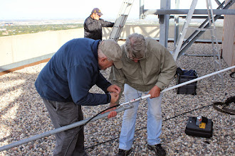 Photo: Ted, VE4VID and Dennis, VE4XE, mouting the 6db UHF Omnidirectional antenna on the mast