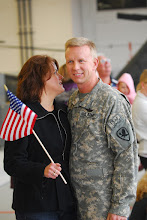 Photo: Five Soldiers from the Minnesota National Guard's Detachment 39 (Det. 39), Operational Support Airlift (OSA) returned to Minnesota Friday.  The Soldiers flew into the Army Aviation Support Facility #1 in St. Paul in the same type of aircraft they flew in theater. Chief Warrant Officer 3 Darin Skopek and his wife were finally reunited Friday. Photo by Sgt. 1st Class Daniel Ewer.