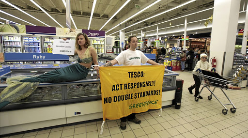 Awareness: Greenpeace activists demonstrate for sustainable seafood policy in this file picture. Labelling seafood raises awareness about conservation. Picture: REUTERS