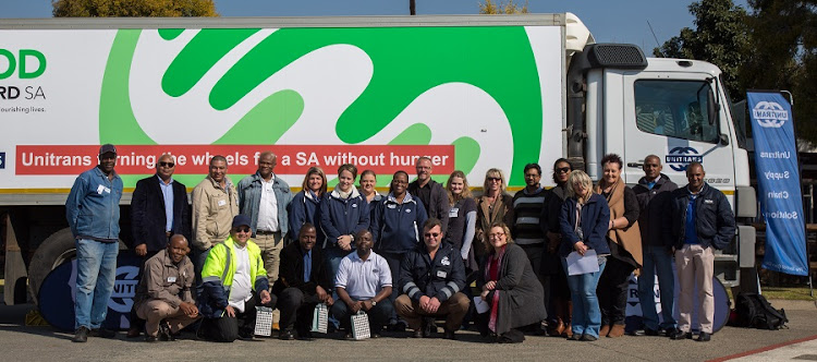 Representatives of Unitrans and Food Forward at the handing over of the truck. Picture: UNITRANS