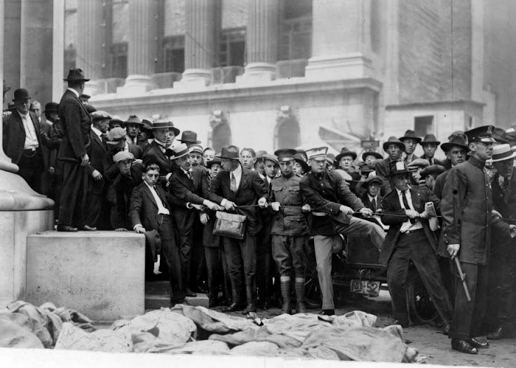 Reporters and observers near the NYSE observe the aftermath of the 1920 anarchist explosion.
