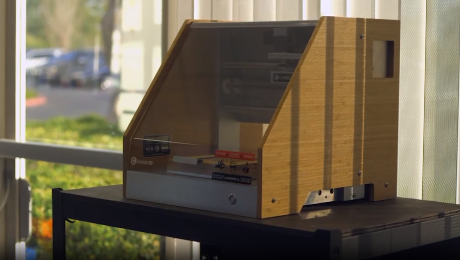 The Carbide Nomad is an example of a small and enclosed desktop mill that sits well on its own, and doesn't need much to set up.