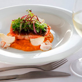 Fillet of Ocean Trout, carrot & ginger emulsion, poached scampi and spring onions