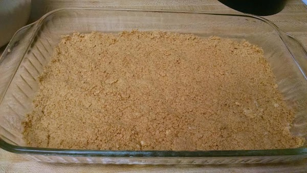 Place 1/2 of the cookie crumbs in the bottom of a sprayed 9x13x2-inch baking...