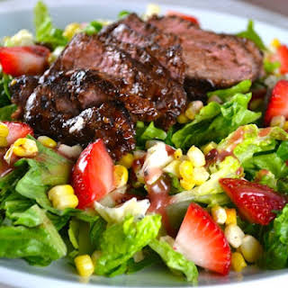 Steak Salad with Roasted Corn, Strawberries, and Blue Cheese.