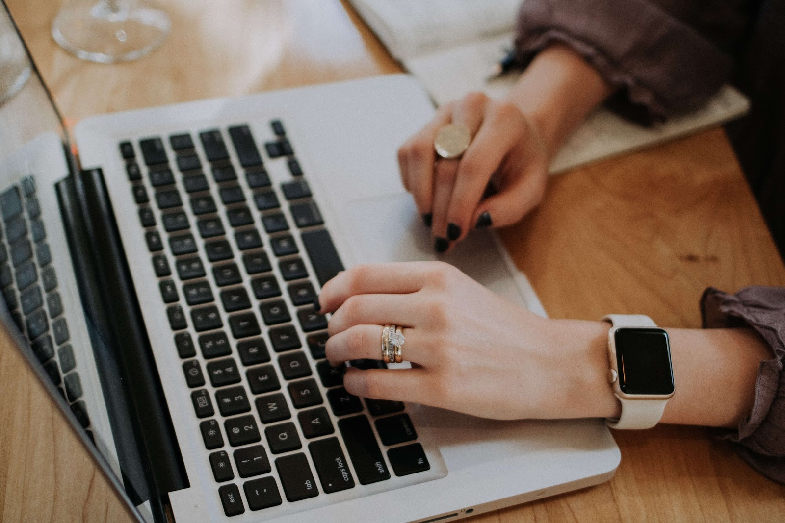 Woman writing optimised content for her business website
