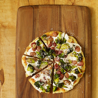FLATBREAD WITH CHARRED BROCCOLI AND ROASTED GRAPES.