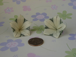 Photo: Model: Plumeria;  Creator: Jodi Fukumoto;  Folder: William Sattler;  1 dollar each;  Publication: The Guide To Hawaiian-Style Money Folds (Jodi Fukumoto) ISBN 0-89610-414-1