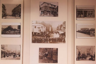 Photo: The library having a little display of bygone Horncastle over the Roman wall remnants.. Clockwise, the Travis Perkins building on Bridge St.; Thorpe & Robinsons drapers; Farm implements at Horncastle station; The rear of the George hotel recieving ale deliveries; After the 1920 flood on West St.; The May-day High St pre 1907, when it was a cul-de-sac at the market, and effectively pedestrianised; a canal boat; and the High st. post 1908 with horse drawn wagons rolling through. In the middle, a circus on it's way to the coast, again post 1908.