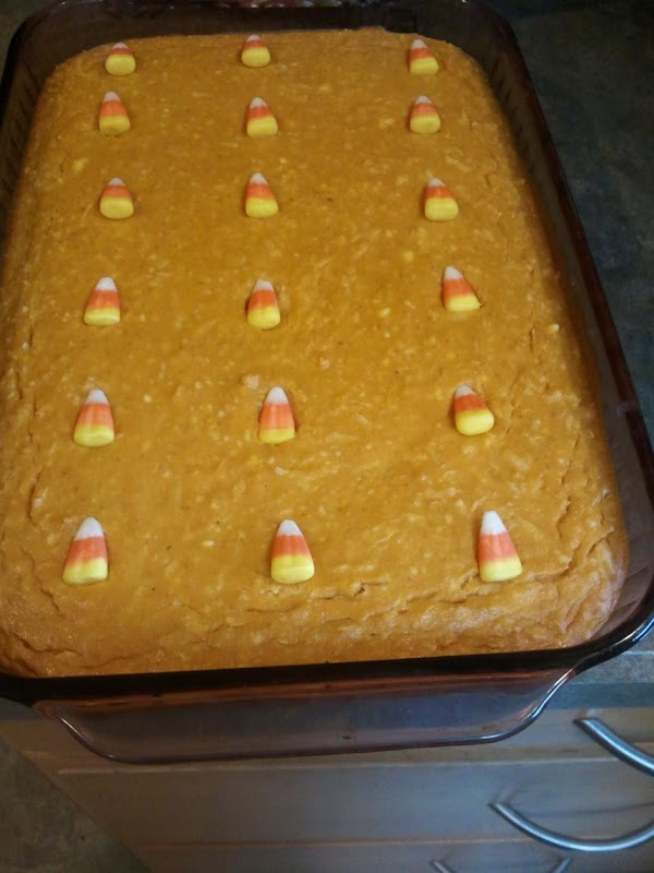 Dish of pumpkin bars before being cut into squares, after cooling & topped with...