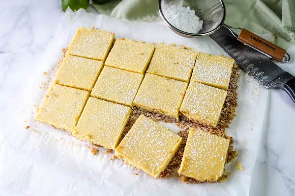 Creamy Lime Bars Cut Into Squares.