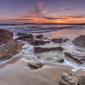 Chiton Rock sunset by Nicole Rix - Landscapes Sunsets & Sunrises ( clouds, water, sand, sunset, beach, seascape, rocks, sun,  )