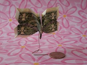 Photo: Model: Butterfly;  There is a light source behind the model, you can just make out the dollar's opposite side image through the thin wings;  Creator: Jodi Fukumoto;  Folder: William Sattler;  1 dollar;  Publication: The Guide To American Money Folds (Jodi Fukumoto) ISBN 0-93154-870-5