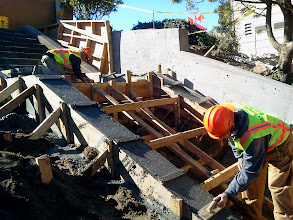 Photo: San Francisco Department of Public Works employees working after second pouring of concrete on Hidden Garden Steps  (16th Avenue, between Kirkham and Lawton streets in San Francisco's Inner Sunset District) in February 2013; for more information about the Hidden Garden Steps project, please visit http://hiddengardensteps.org.