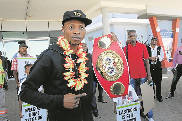 09 March 2015, THE RINGMASTER: A garlanded IBF champion Zolani 'Last Born' Tete shows off his belt after touching down at the East London Airport yesterday following his victory over Englishman Paul Butler on Friday.