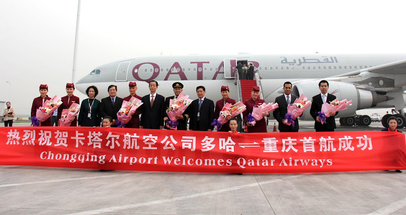 Photo: Government, airport and Qatar Airways officials are pictured at Chongqing Jiangbei International Airport following the arrival of the carrier's inaugural flight to its fifth Chinese destination.