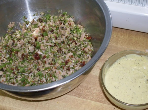 Mix dressing ingredients together and set aside. Toast split criossants under the broiler for...