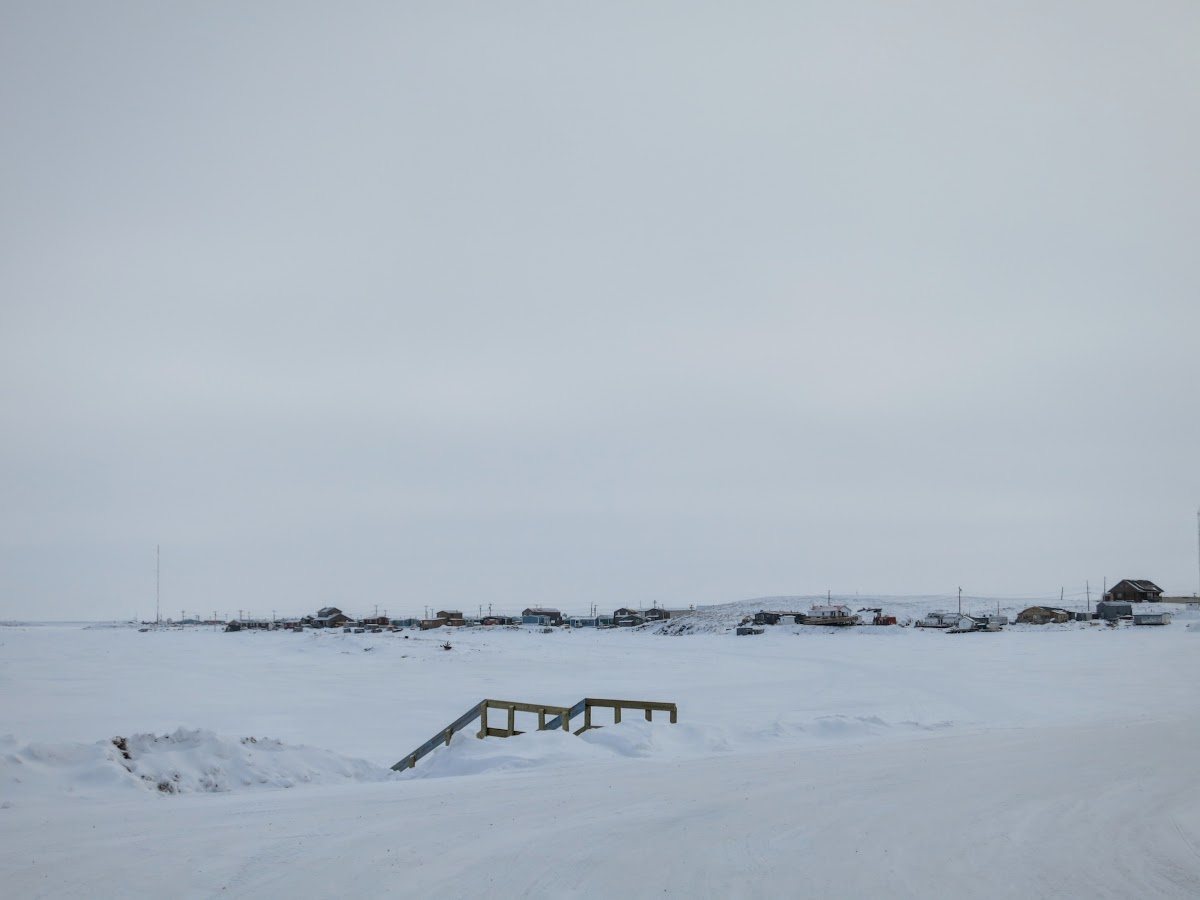 Arriving Tuk and the frozen Beaufort Sea