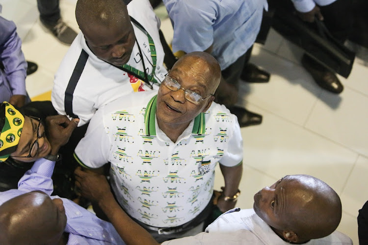 Jacob Zuma looks at stalls and greets exhibitors at a exhibition centre hosted at the National ANC Elective Conference in Nasrec, Johannesburg.