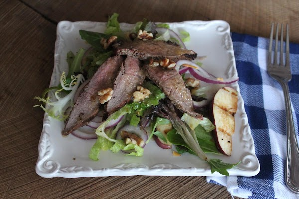Serve by topping the salad ingredients with the steak and sprinkling with the walnuts....