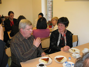 Photo: Here Anne is enjoying her cheesecake and conversation with Kring president, Chris Morias.