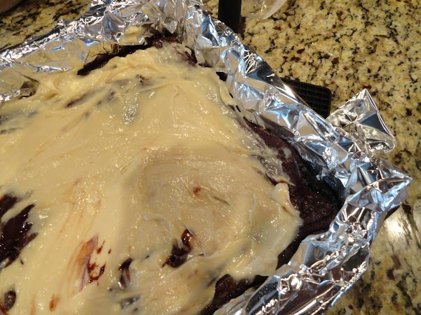 Pour over baked brownie mix and return to the oven.  Bake for an...