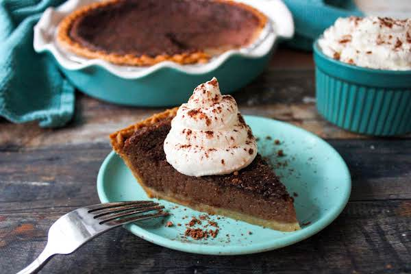 Slice Of Chocolate Chess Pie On A Plate With Whipped Cream.