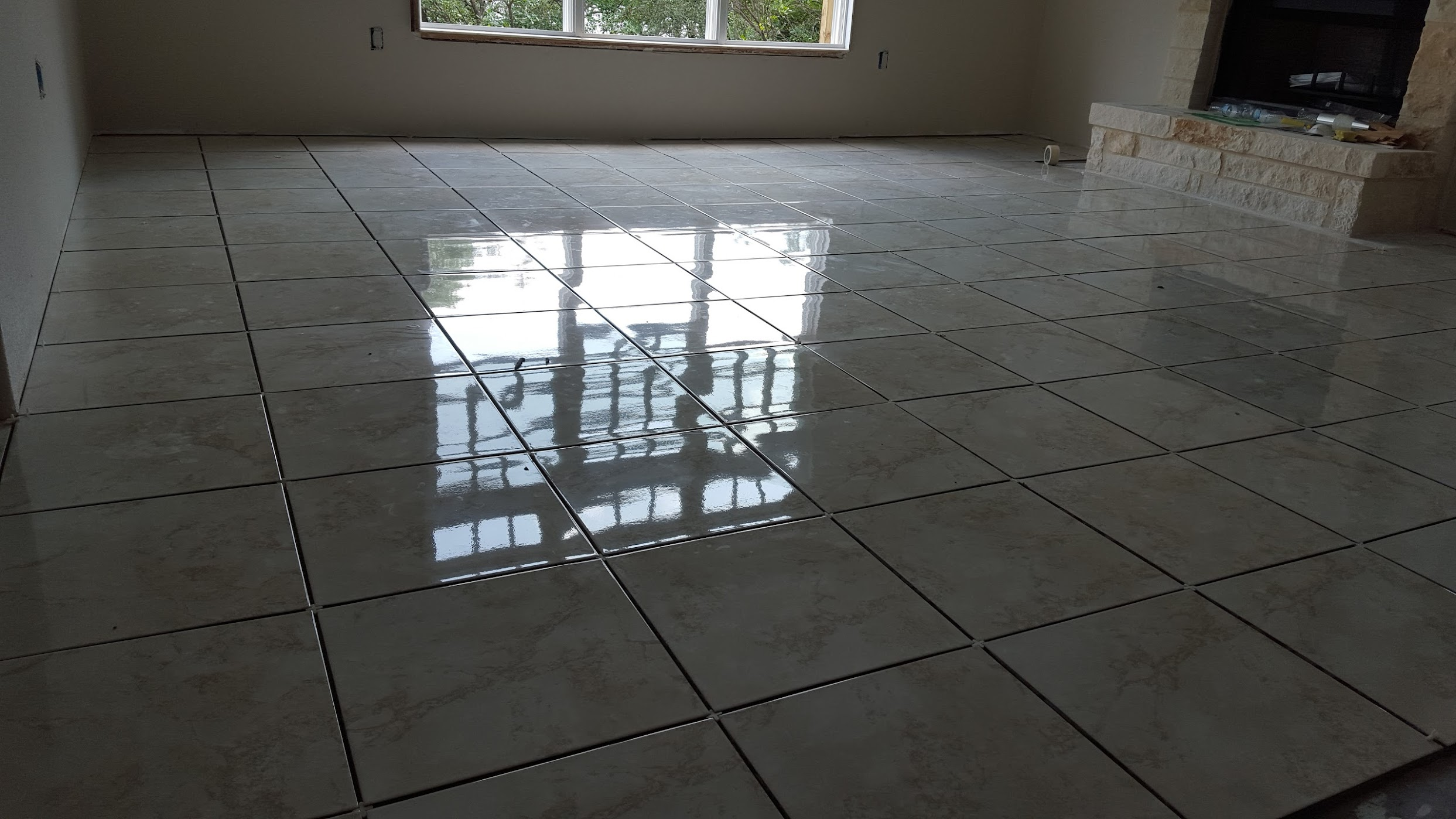 Living room tile floor project r m flooring remodeling tile flooring san antonio dailygadgetfo Image collections