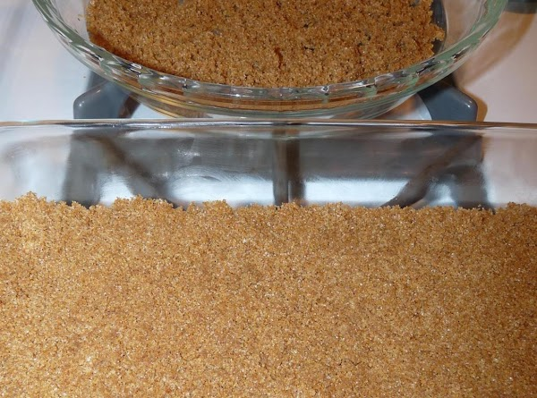 To make the crust, grind crackers and sugar in a food processor until crumbs....