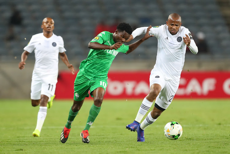 Ali Sadiki of Platinum challenged by Luvuyo Memela and Xola Mlambo of Orlando Pirates during the CAF Champions League match between Orlando Pirates and Platinum at Orlando Stadium, Johannesburg on 08 March 2019.
